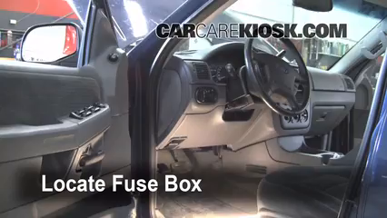 locate interior fuse box and remove cover - 2005 Ford Explorer Interior
