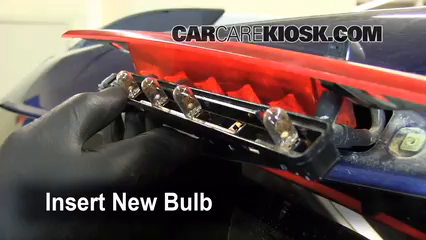 how to change a ford focus brake light bulb