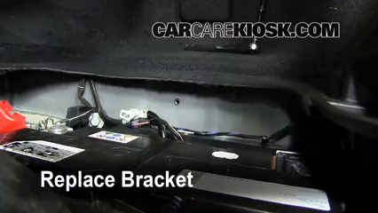 how to change battery in mazda 3 2009 key