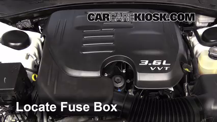 replace a fuse 2011 2014 dodge charger 2013 dodge charger se locate engine fuse box and remove cover